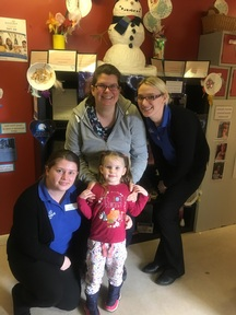 Elizabeth and Amelia Corbett with nursery practitioners Danielle Hasell and Emma Dodds