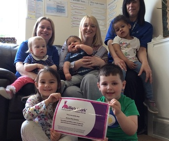 Staff at Barton Moss Nursery celebrate achieving Millie's Mark   Credit: Barton Moss Nursery