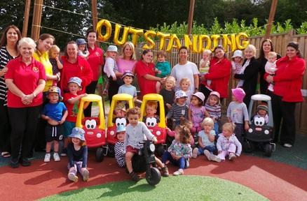 Monkey Puzzle Day Nursery Tatsfield celebrating their 'outstanding' award