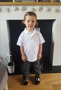 Credit: Mark Duffy. Grace dressed in her uniform for her first day at nursery.